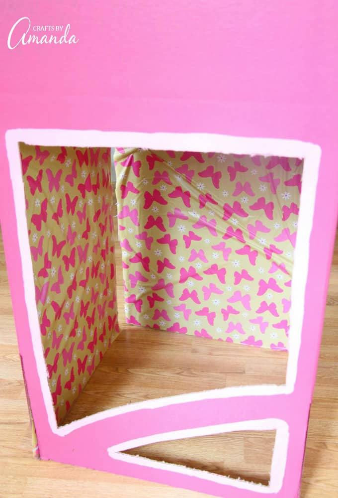 pink painted box with wrapping paper inside