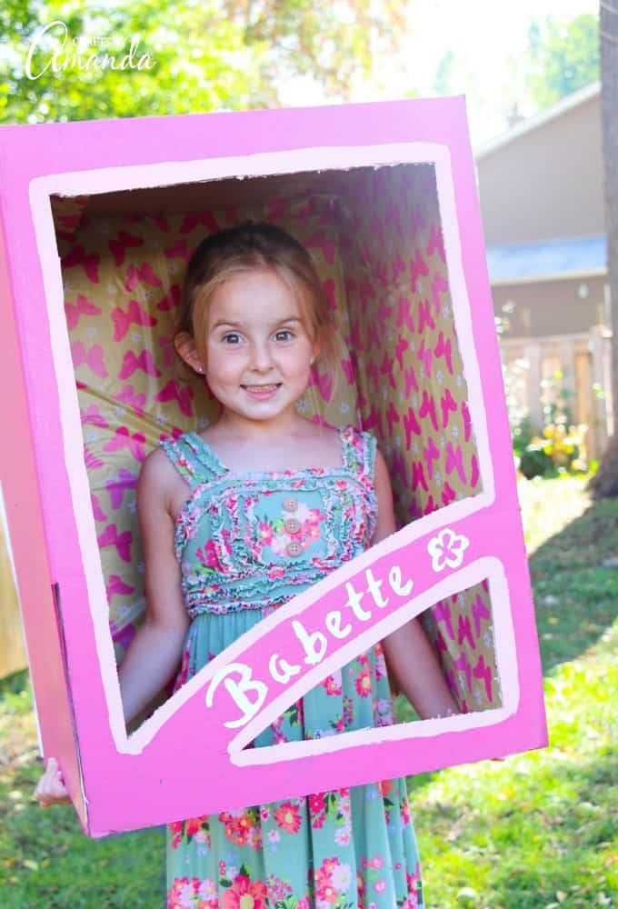 little girl as a doll in a box