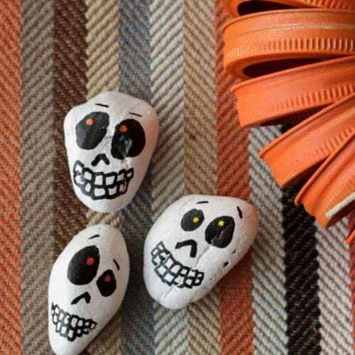 Make adorable skull rocks with the kids! Easy to make and fun decorations for Halloween.