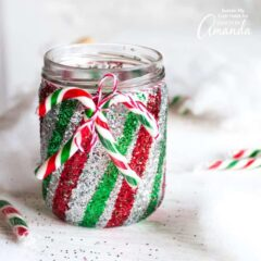This colorful, glittery candy cane Mason jar luminaryis a festive way to add some twinkling warmth to your Christmas decorating.