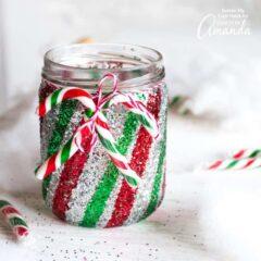 Mason Jar Luminary Candy Cane Inspired Glittery Mason Jars