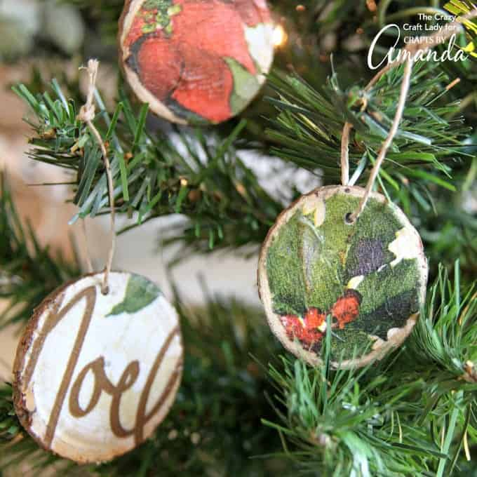 These decoupage wood slice ornaments are an easy way to make your own tree ornaments. Use paper napkins in any pattern or color to make custom ornaments.