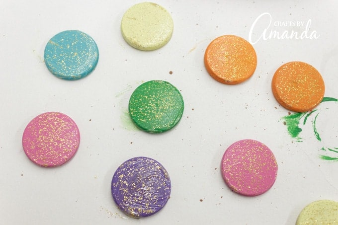 Once the wood circles are dry, add a thin layer of Gold Rush glitter paint.