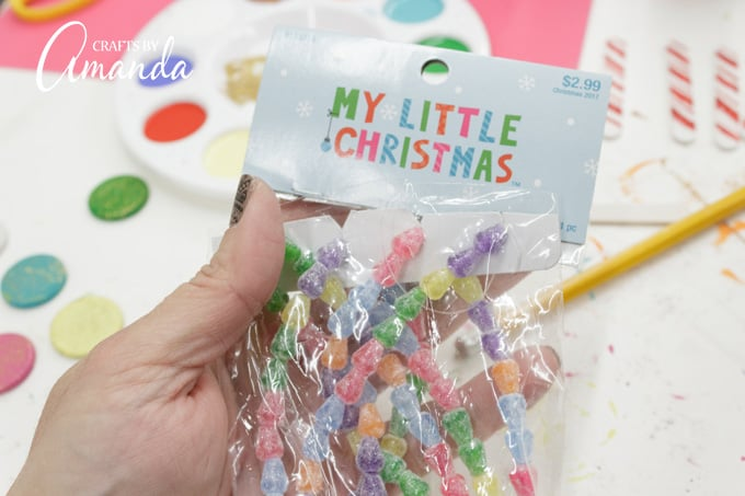 Miniature Christmas tree decorations are great for making a birdhouse gingerbread house.