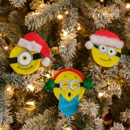 Turn ordinary canning lids into adorable minion ornaments for Christmas! A fun project to do with your minion loving kids this winter break!