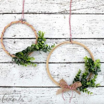 Learn how to make a simple winter greenery embroidery hoop wreath. This easy to make wreath is perfect for decorating throughout the winter.