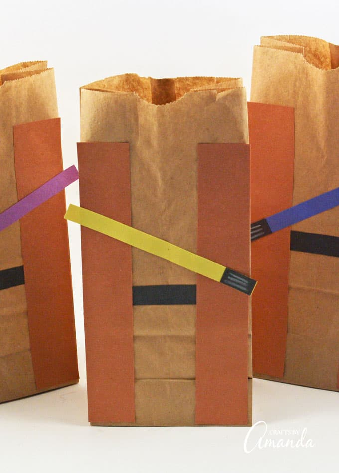 Jedi Party Favor Bags: made from colorful construction paper and paper bags