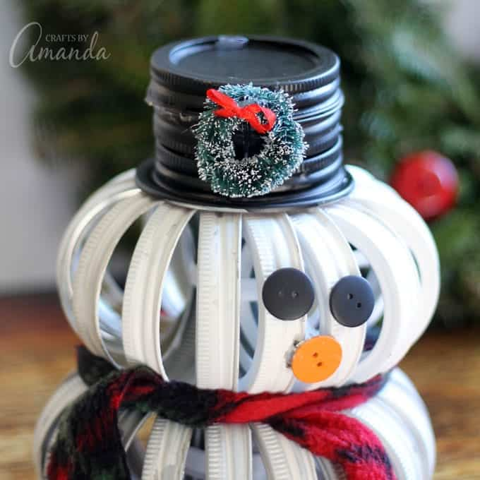 snowman made out of mason jar lids