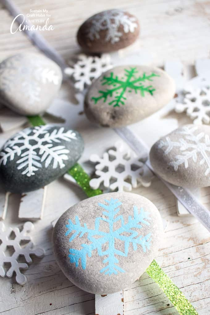 Rock painting continues to be a popular and inexpensive craft. Hop on the bandwagon with these stone cold snowflake painted rocks for the holidays.
