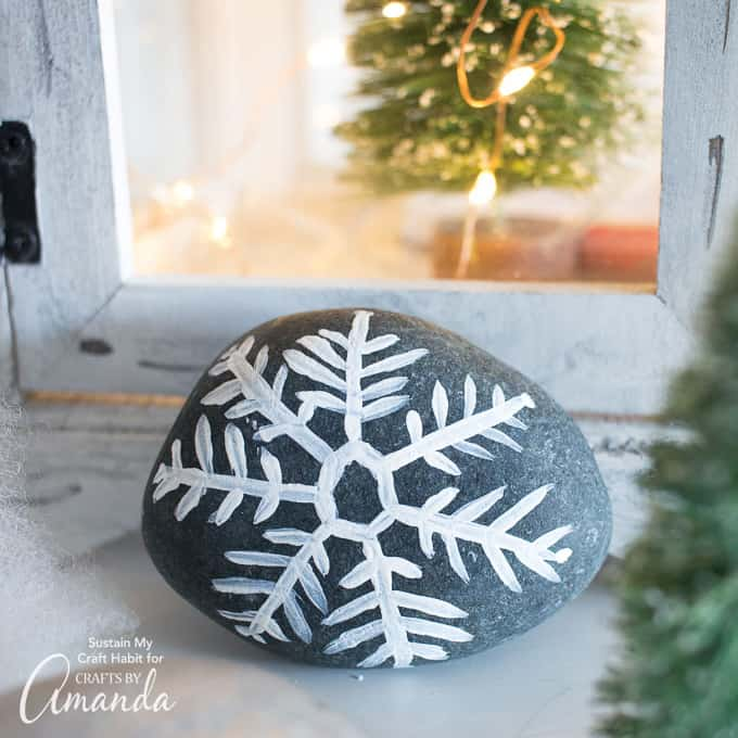 Make your own pretty painted rock snowflakes and pass them out to friends, family, or as a secret rock exchange!
