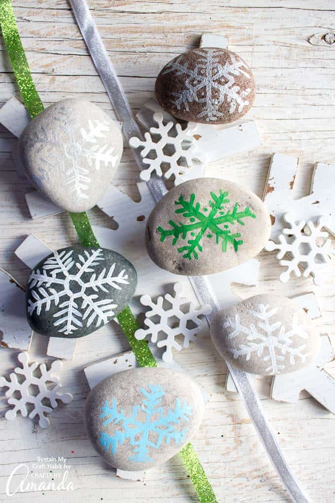 Christmas rock painting: painted rock snowflakes