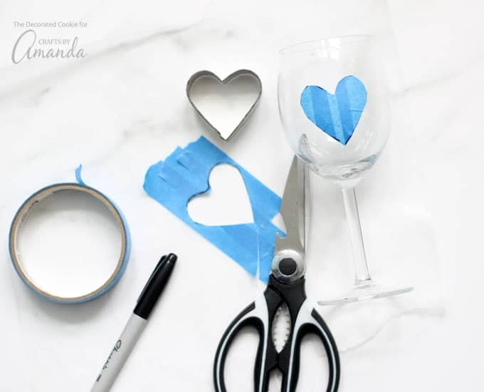 Painting wine glasses, using a template from tape and a heart cookie cutter