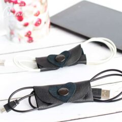 Get your rampant collection of unruly cords organized with these useful and simple DIY leather cord organizers for electronics. With a little heart embellishment, these make a great DIY Valentine's Day gift for him or her!