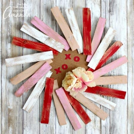 This wood shim wreath is the perfect decoration to add to your Valentine's Day mantel!