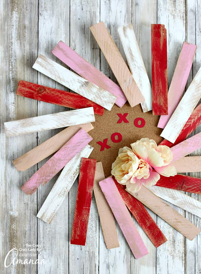 We've got you covered on how to make a simple Valentine wood shim wreath