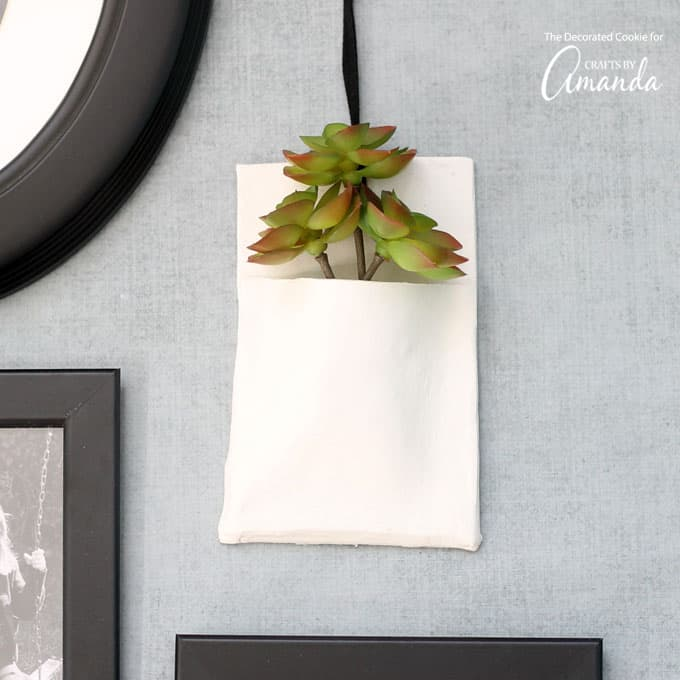 I love this homemade clay wall vase. It's so easy to make using air-dry clay, and it adds unique character to your wall display. Paint it your favorite color, or leave it bare as is. Because all of my walls are colorful, I opted to leave it as is.