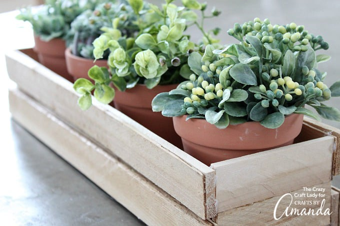 Wood shim planter box with terra cotta plants