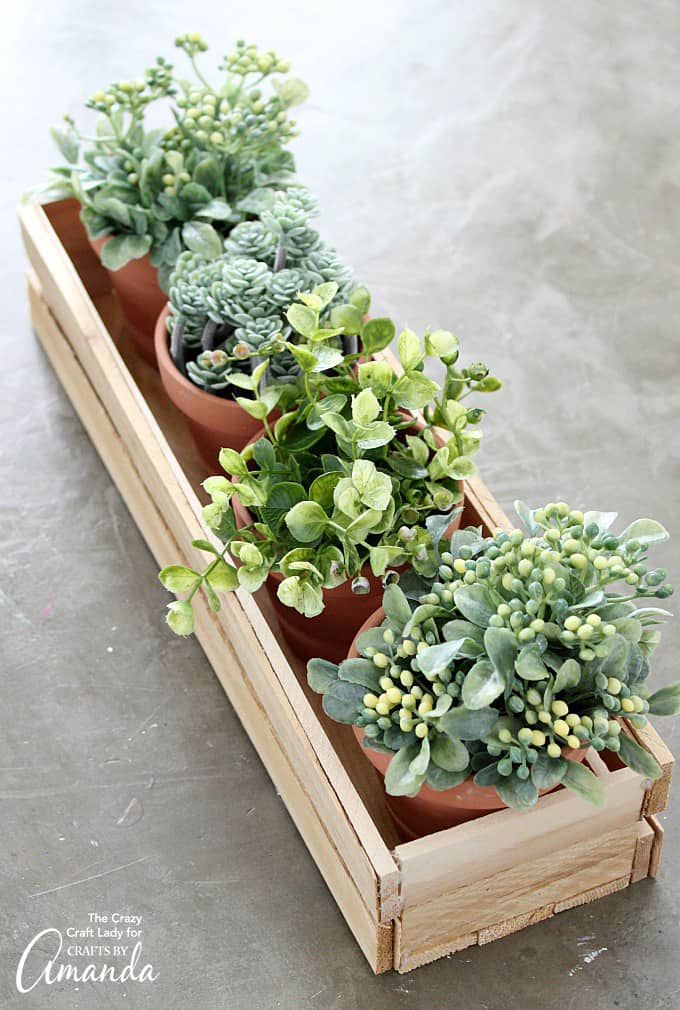 You won't believe how easy it is to make this wood shim planter box, no power tools required! You can leave this project as bare wood, or paint it whatever color you like.