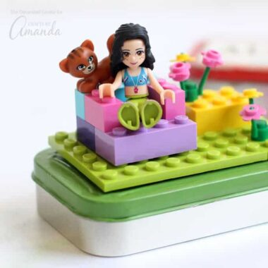 These cute LEGO Altoid tins are perfect recycled craft. They make fun mini travel kits to keep kids busy in the car or on a plane. Or, you can make up a bunch for fun birthday party favors.