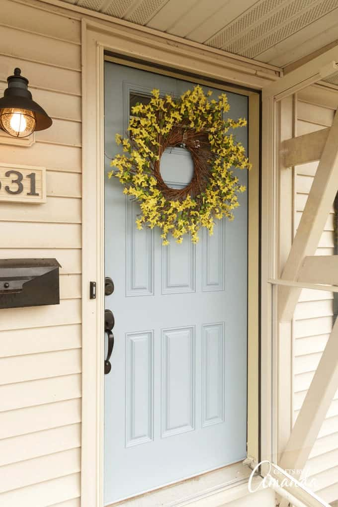 Forsythia wreath on blue door