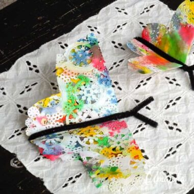 Butterfly crafts are fun for kids and a great way to celebrate spring! These colorful paper doily butterflies are made from food coloring and paper doilies!