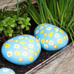 Join along with the rock painting trend and enjoy making your own all over daisy painted rocks. You can scatter these painted rocks throughout your home, yard or inside your potted flowers!