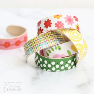 You can personalize these popsicle stick bracelets with any paper design you like, or make this a kid-friendly project, and let kids decorate the shaped bracelets with paint.