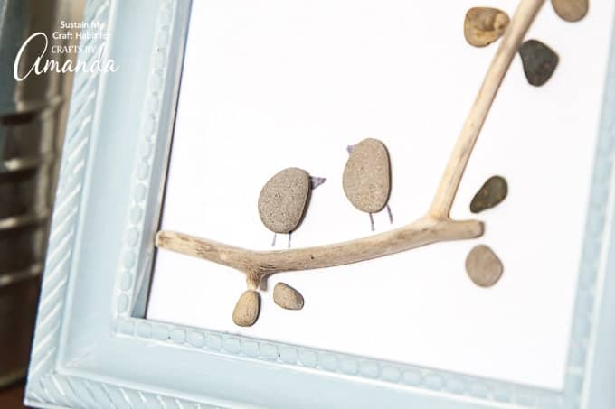 Make your own DIY pebble art birds on a branch!