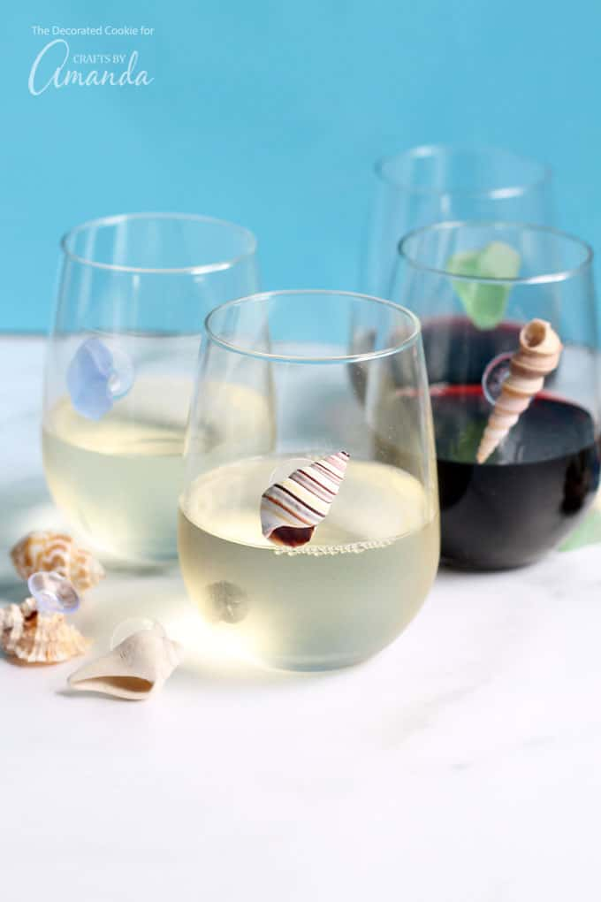 Seashells suction cupped to a wine glass