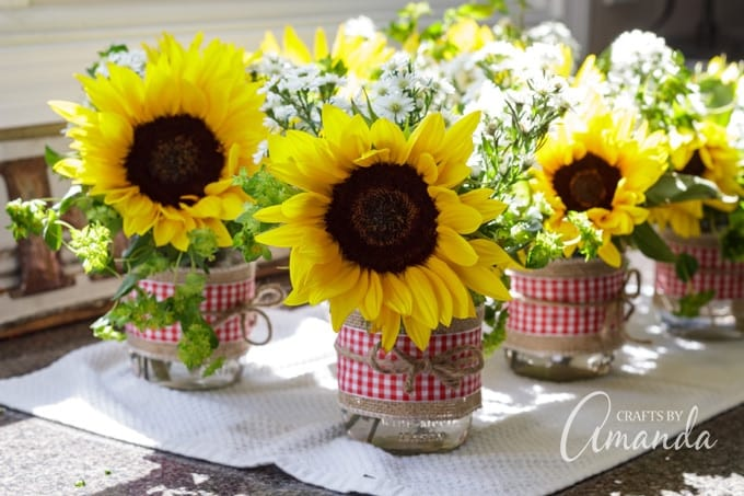 fresh sunflowers in barbecue themed jar centerpieces for bridal shower