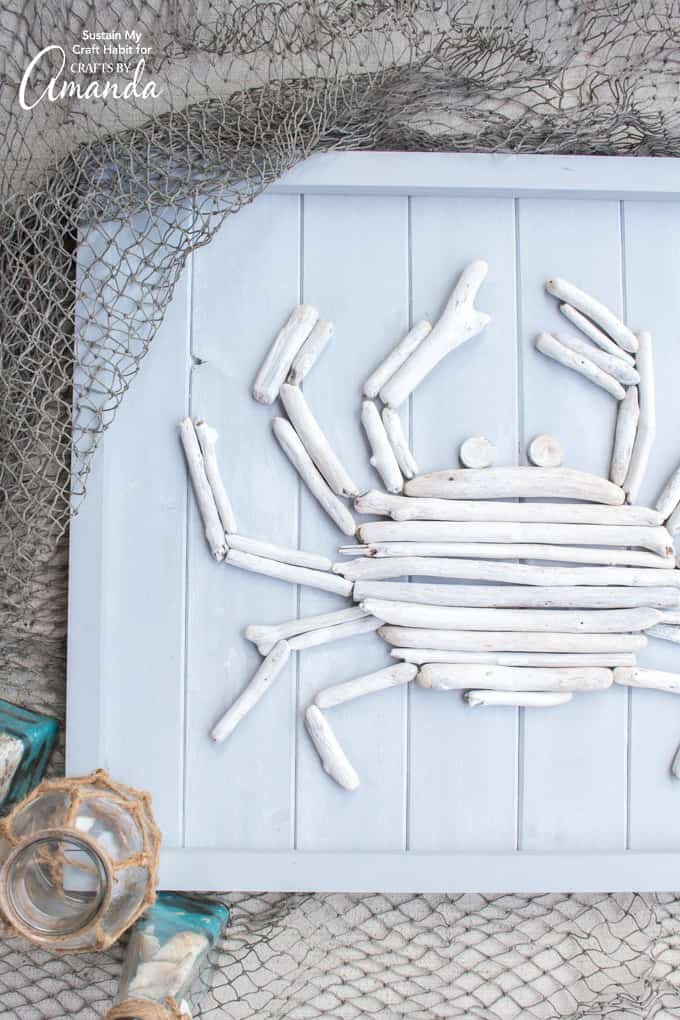 Driftwood Crab Wall Art surrounded by fishing net