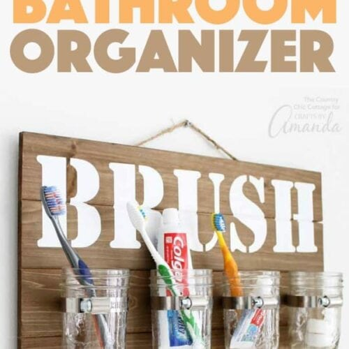 Organize your bathroom with this mason jar bathroom organizer for toothbrushes. Optimize your storage and counter space with this wall hang. #organize #bathroomdecor #bathroomdiy #wallart #rustic #farmhouse