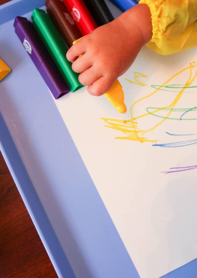 toddler hand holding marker