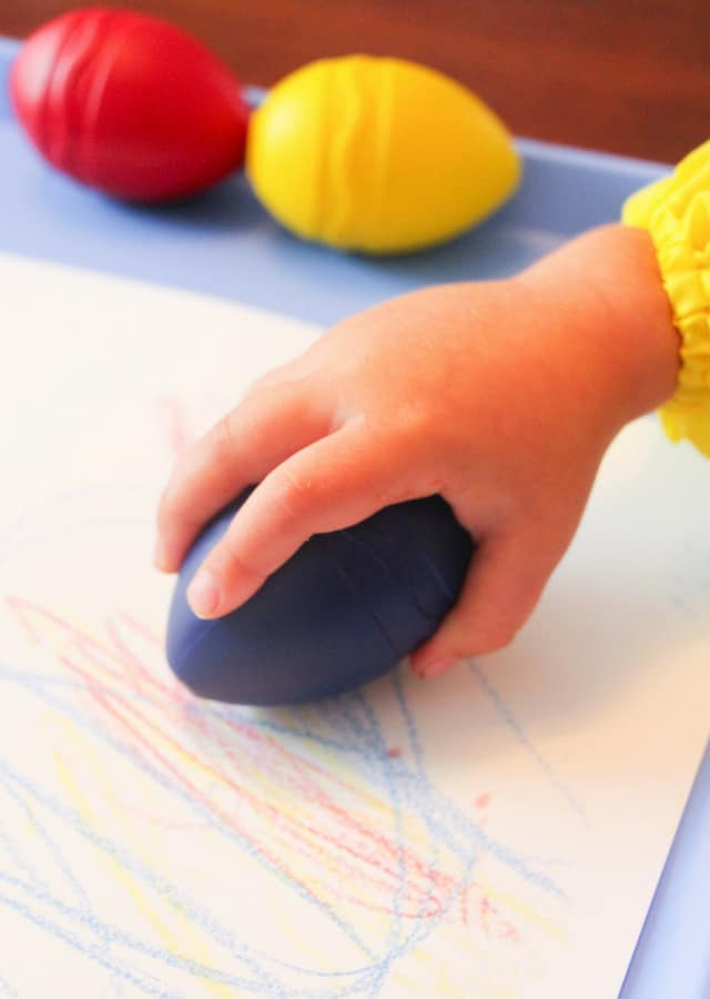toddler using large crayon