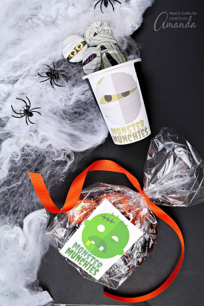 Monster stickers on treat bags and treat cups for Halloween