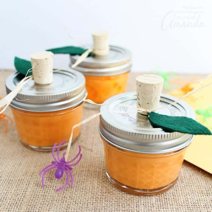 Orange slime made to look like pumpkins in a mason jar