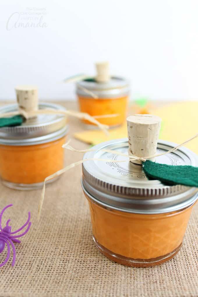 Orange slime in mason jars with a wine cork top and felt leaf