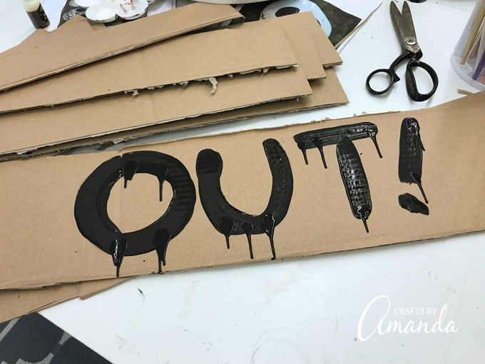 painting words on cardboard