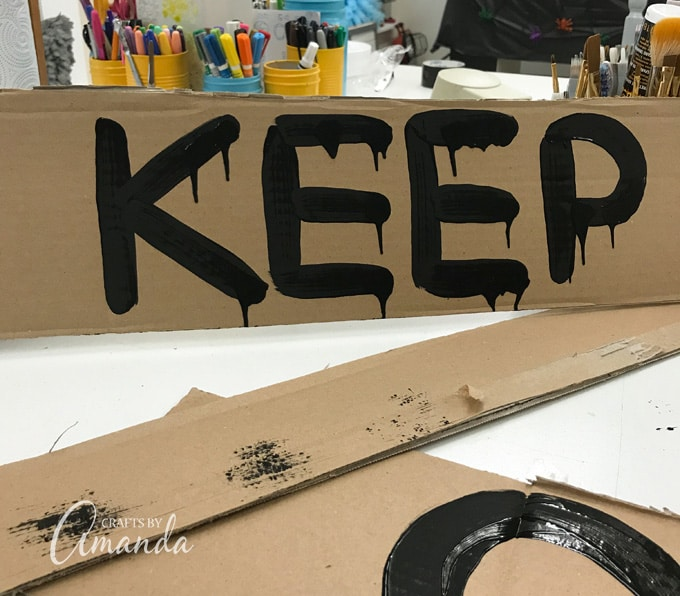 cardboard painted with words