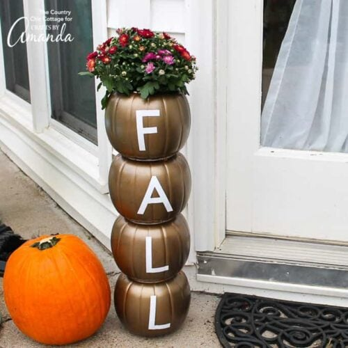 Easily make this stacked pumpkin planter using plastic pumpkins from the dollar store and some vinyl adhesive letters for a fun fall statement piece!