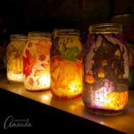beautiful fall and halloween mason jar luminaries made from paper napkins and mod podge
