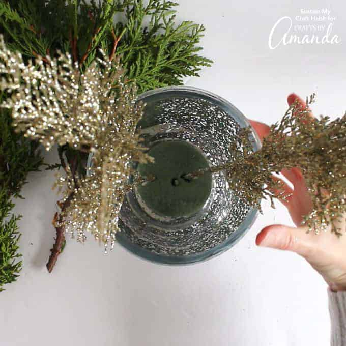 Add pieces of greenery to floral foam