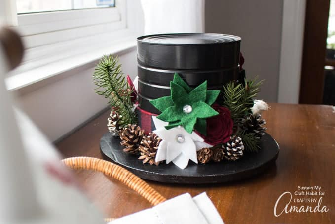 snowman hat centerpiece made from felt flowers and a coffee tin can.