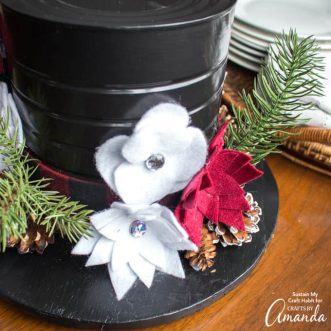 Snowman hat centerpiece with felt flowers and greenery