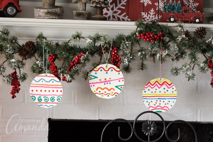 paper plate ornaments on mantel