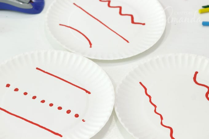 paper plates with crayon