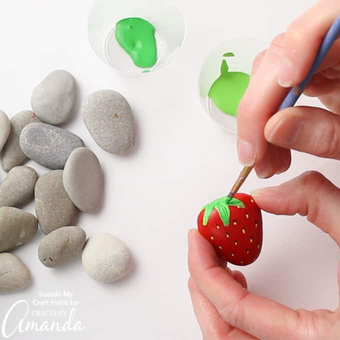 painting leaf onto strawberry rock