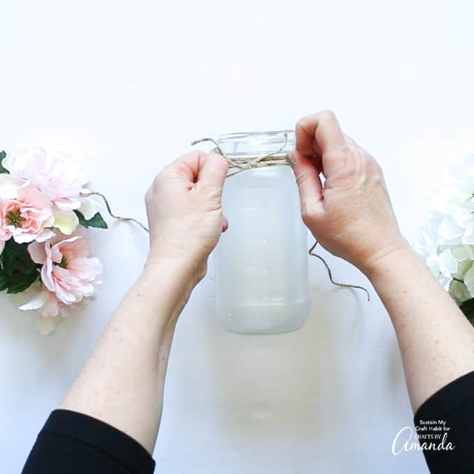 Tie on the twine around the rim of the mason jar