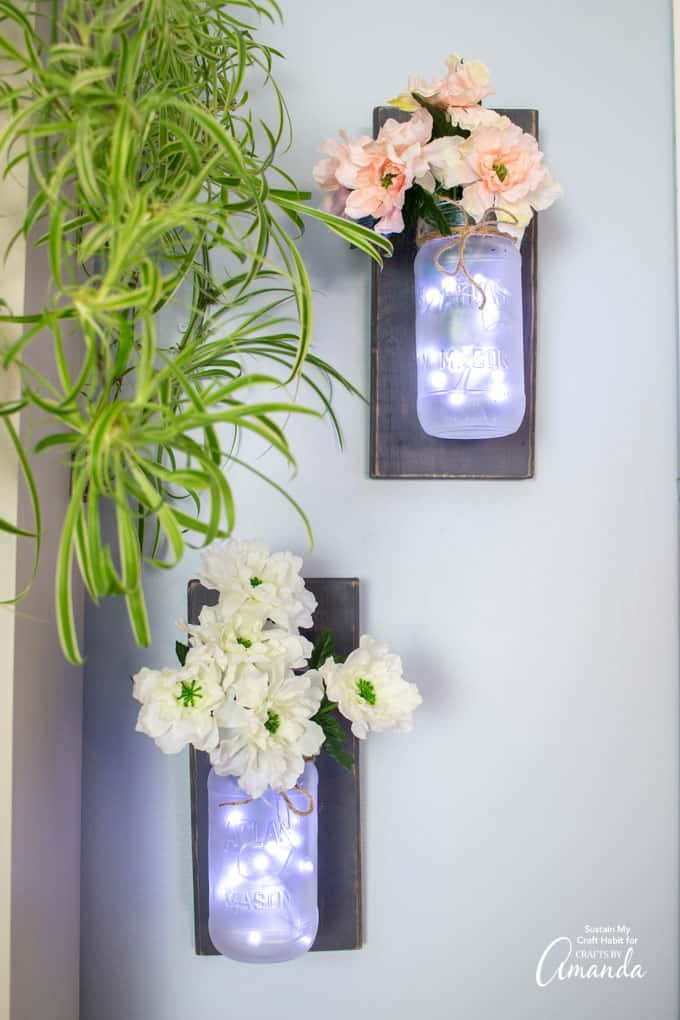 Mason Jar Wall Sconces with faux flowers and fairy lights