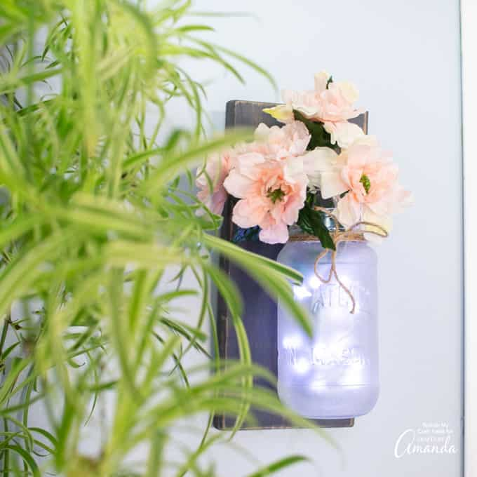 mason jar wall sconces with fairy lights and flowers